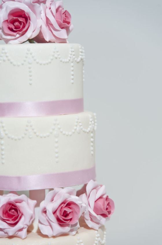Pink and white wedding cake by Cakings via Nu Bride