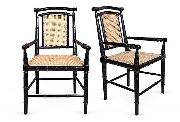 Pair of new Colonial-style dining chairs with hand-rubbed black finish, natural cane on seat and back, and bamboo-style turned mahogany.