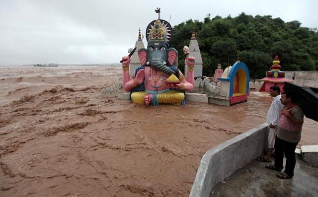 Article: A temple to to the god Ganesh is immersed in floodwaters in Indian-administered Kashmir after the worst floods in half a century.
