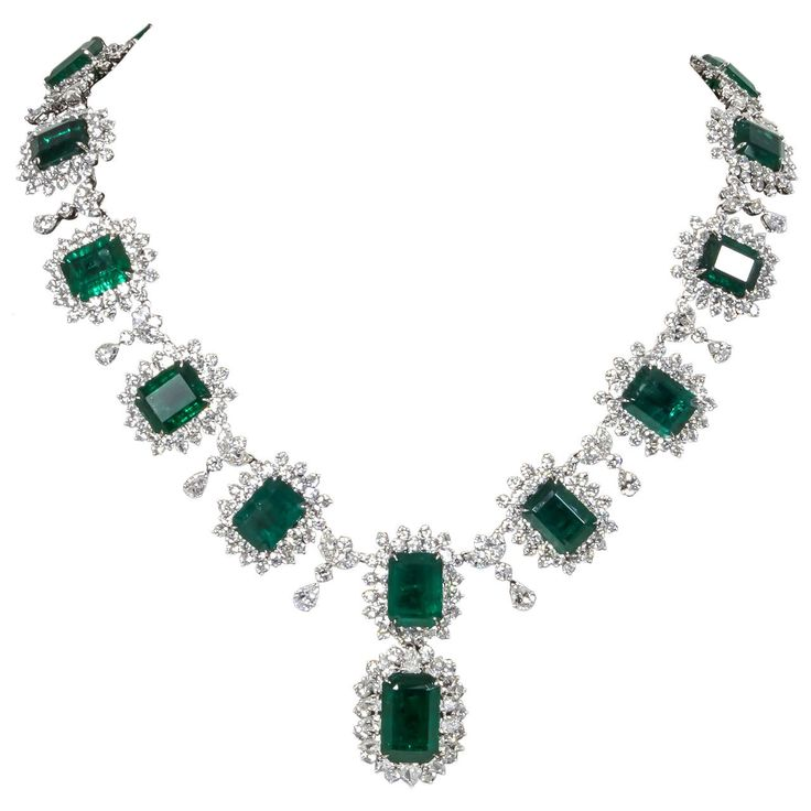 Iconic Emerald Diamond Platinum Drop Necklace | From a unique collection of vintage drop necklaces at https://www.1stdibs.com/jewelry/necklaces/drop-necklaces/