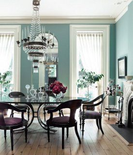 If the proportions of your dining room are meant for the stage, a coat of green-blue with white trim could be your ticket.