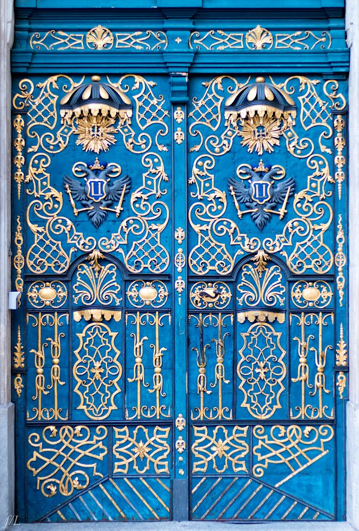 Wroclaw, Poland. Blue door with gold detail. Door design inspiration