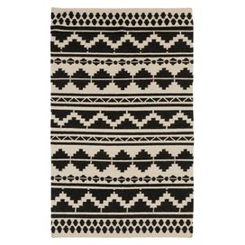 Showcasing a Southwestern-inspired motif in gray and caviar, this hand-woven wool rug adds a pop of pattern under your dining room table or in the entryway.  Product: RugConstruction Material: WoolColor: Feather gray and caviarFeatures: FlatweaveNote: Please be aware that actual colors may vary from those shown on your screen. Accent rugs may also not show the entire pattern that the corresponding area rugs have.