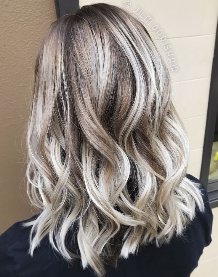White ash blonde balayage, shadow root, curls in a textured lob, holiday hair