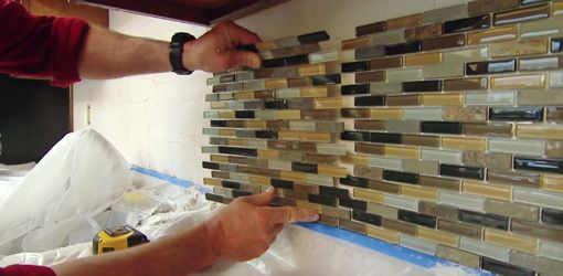 Watch this video to find out how to tackle some great DIY kitchen upgrades, including adding a tile backsplash, decorative display shelf, and water filtration system.