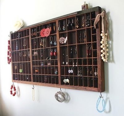 On the wall jewellery storage shelving unit.