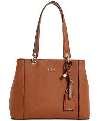 593029f37d5e Shop GUESS Kamryn Shoulder Bag online at Macys.com. Carry chic versatility  with this structured tote by GUESS, shaped in rich faux leather that  provides ...