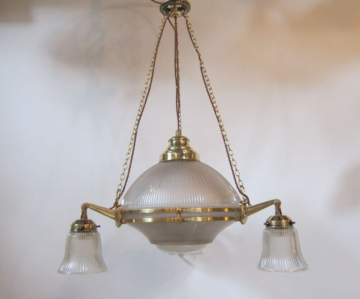 Good size English three arm ceiling light in polished brass, complete with the original three part central shade surrounded by three further holophane glass shades.  www.antiquelightingcompany.com
