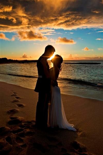 Sucha pretty pic..like the way the bottom of the dress flows, beach wedding bride and groom