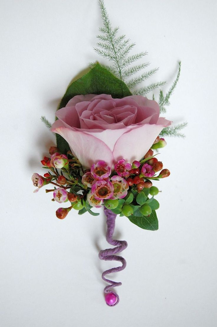 .Corsages 2 cream roses, bracken? berries different perhaps twiddly bit different