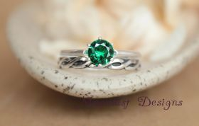 Emerald Green Spinel Solitaire Wedding Set with Sterling Notched Celtic Pattern Band, Vintage-Style Classic Solitaire Celtic Engagement Set.  Some believe the emerald to be a stone of inspiration and infinite patience, and that it embodies unity, compassion and unconditional love.  Repin this lovely ring set to your own inspiration board!
