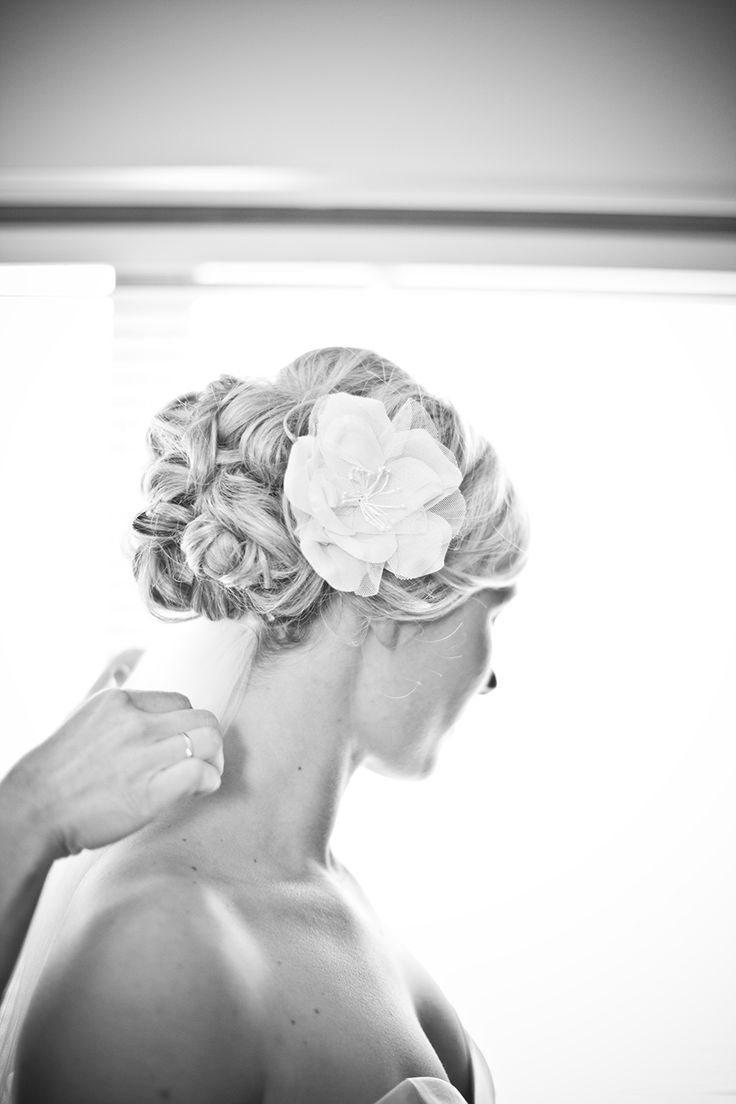 A stunning up do with detail and not to mention jess having a flower created for her hair out of the same material of her dress.