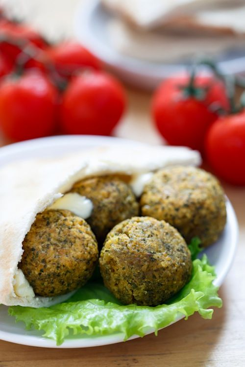 This baked falafel balls recipe is deliciously Mediterranean without the fat of fried falafel. Toss twith lettuce, tomato and hummus for an incredible meal.