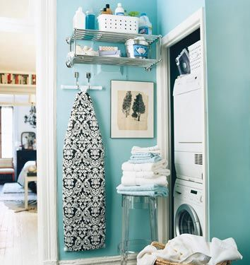 Tiffany Blue Laundry Room - Turquoise blue walls, lucite acrylic stool, stacked white washer & dryer and white & black damask ironing board cover.