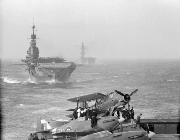 Seen from the flight deck of HMS Victorious a Fairey Albacore takes off from HMS Indomitable while HMS Eagle brings up the rear. Eagle was lost during the operation Pedestal