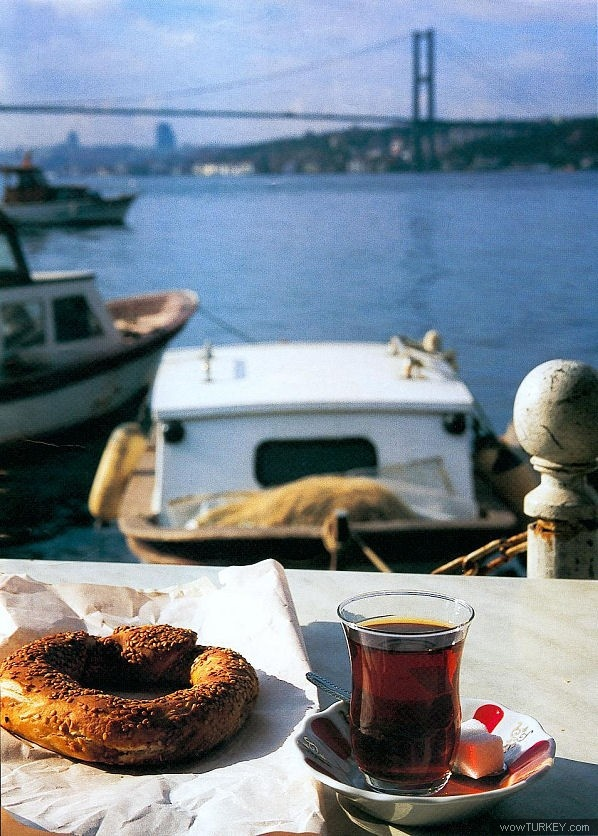 Çay ve Simit  Turkish bagel with sesame, tea and the Bosphorus landscape.