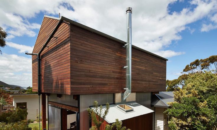 The exterior cladding will develop a gray patina over time.