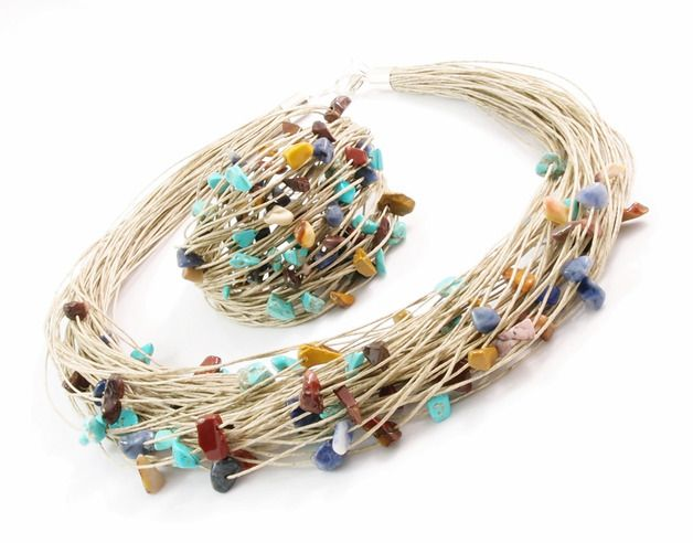 Sophisticated, handmade necklace and bracelet made of very soft to touch, high quality linen. Incredible mix of colours. The necklace is about 45 -47 cm long. The bracelet is about 16-18 cm long....