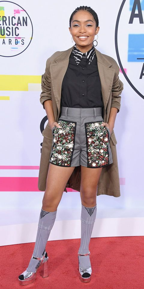 Yara Shahidi showed us how to make shorts wearable even when the temperatures start to drop. Just add cozy socks and a cool coat, and you're good to go. Here, Shahidi is wearing pieces from Prada's Spring 2018 collection and Mateo jewelry.