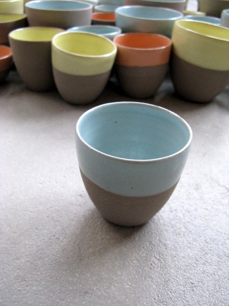YEHHH - the first espresso cup is up out of the Stone & color collection.  Grey smooth stoneware with eggshell mintgreen glazzzzzzzzze!! :)