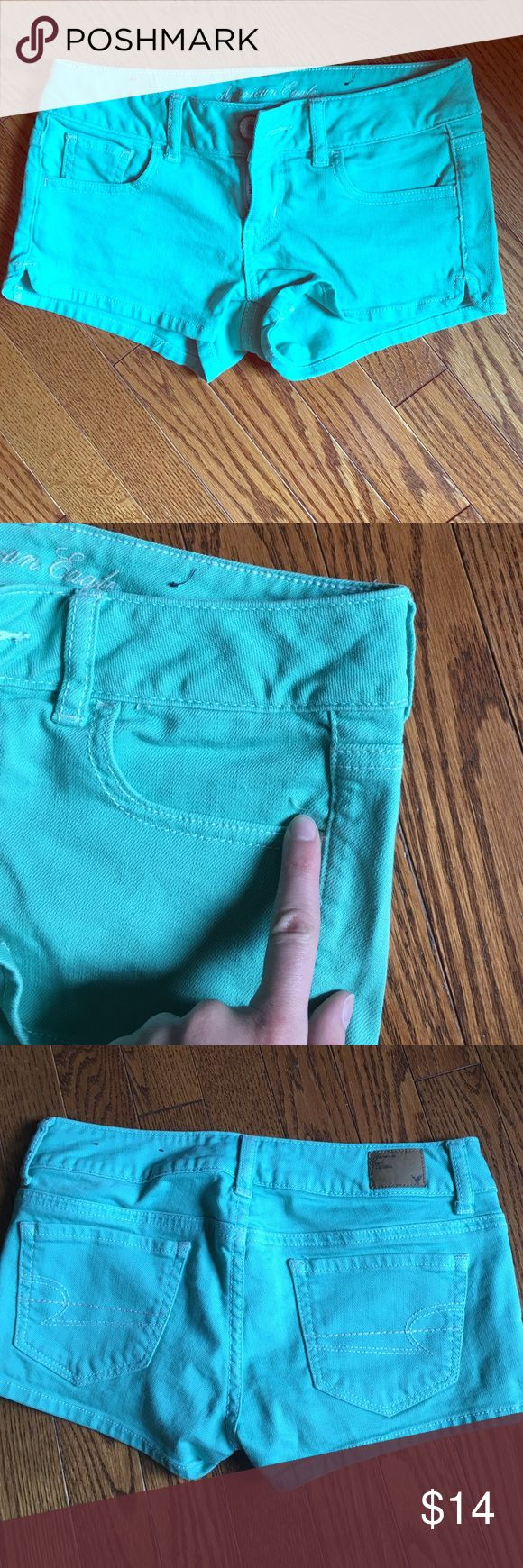 American eagle Aqua shorts size 0 Pretty Aqua colored shorts. Hardly worn size 0 tiny snag in picture more of a green/blue tone than picture shows American Eagle Outfitters Shorts Jean Shorts