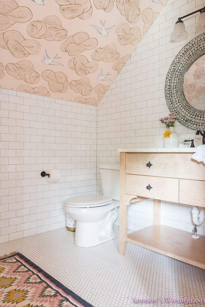 A Tiny Little Bathroom Design... Addison's Suite Reveal Part #2! - Addison's Wonderland... White subway tile and white hexagon tile from Shaw Floors, pink aztec rug, whitewashed custom single vanity, daydream blush wallpaper, round mirror and oil rubbed bronze faucet.