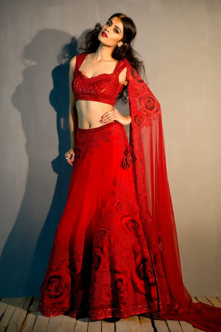 Beautiful Rose lehenga with crystal embellished blouse and patched work to enhance your beauty. Don;t miss the offer and order your designer bridal lehengas online NOW. For more  offer and products visit www.satyapaul.com