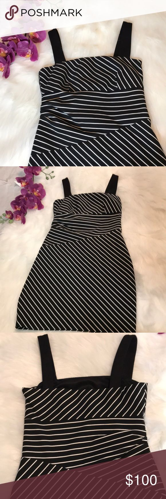 "CYNTHIA STEFFE STRIPED DRESS SZ 0 NWOT NWOT NEVER WORN PERFECT CONDITION.... CYNTHIA STEFFE BLACK AND WHITE STRIPED DRESS SIZE 0, ZIPPERS AT THE SIDE, MEASURES 26""LENGTH 28"" WAIST AND 26"" BUST. GREAT DRESS FOR A NIGHT OUT Cynthia Steffe Dresses Mini"
