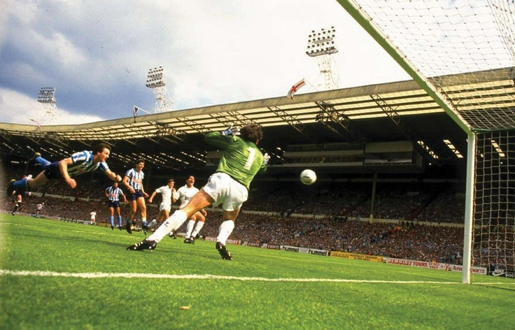 "The iconic ""Houchen Header"" - Keith Houchen's diving header that was impossible for goalkeeper Ray Clemence, from the opposing Tottenham Hotspur, to save. As well as his FA Cup winning medal, Houchen's header also earned him the BBC Match of the Day's Goal of the Season award for the 1986–87 season."