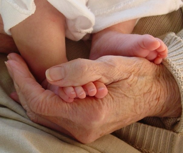"One of my most cherished pictures, ""Her hands, her feet"".  Shortly after it was taken Grandma passed away."