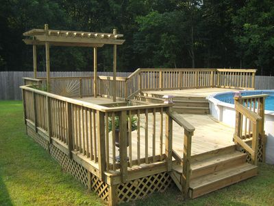 Multi level wood deck for pool with pergola pool decks for Multi level deck above ground pool