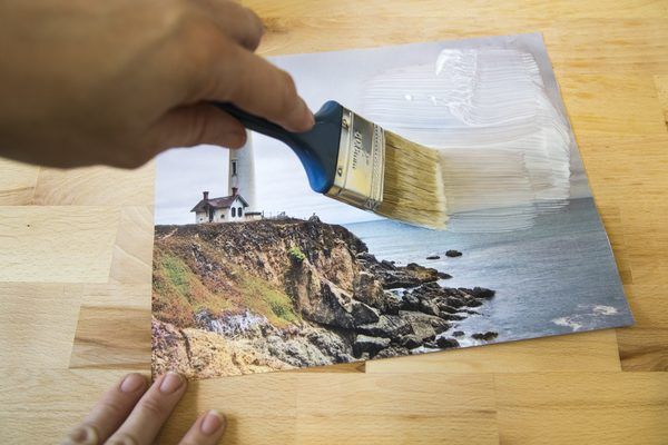 Mod Podge is a gel-based product associated with decoupage, the procedure in which paper is layered to create a design. Since 1967, the Plaid Company has offered this product as an adhesive and sealer for craft projects. Gel mediums such as Mod Podge can pull the ink off a printed image. This allows you to take a picture and transfer it onto canvas...