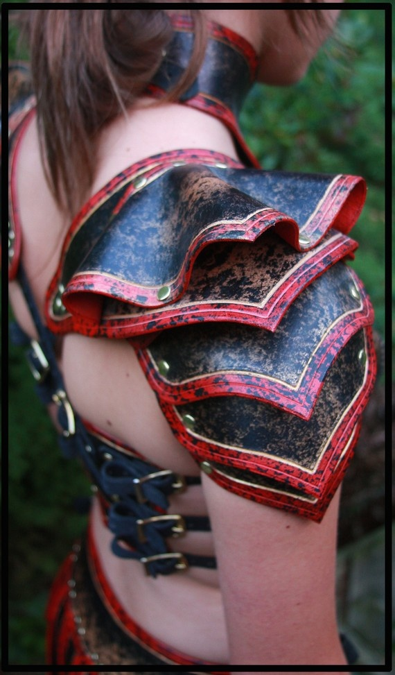 Plastic, paint and office brads. Shoulder Armor, loving the fabric like fluting