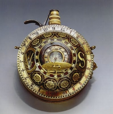 Portable watches had only been around a few decades when this multi-function timepiece was built in southern Germany circa 1590.    Consisting of a round powder flask made of rosewood with inlaid and engraved rosette-shaped ornaments of brass and bone. A small clock with 1-12 hours twice situated on the outer ring. The small funnel of bone is closed with a springy lid made of brass. Below the center under the engraved lid with a transversally placed hinge, there is a horizontal sundial with…