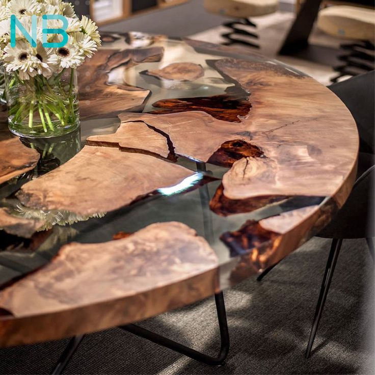 #Inspiration: Can you believe this eye-catching #table top was made with 50K year-old #wood inlay? Designed by Italian #furniture design firm Riva 1920, The Earth Table is both artistic and functional. This inspired #Neo_Brand to blend in a shade of Mother Nature on our creation.  #contemporaryart #creativeart #urbanart #modernart #woodentable #custommade #woodencraft #craftsman #design #style #decoration