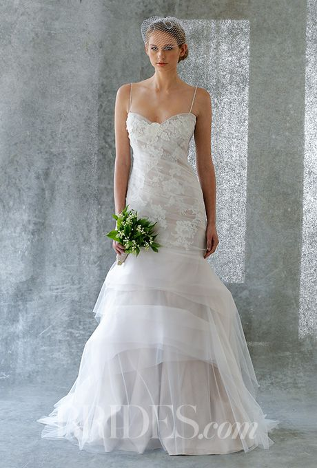A @jennyleebridal wedding dress with a tiered tulle mermaid skirt | Brides.com
