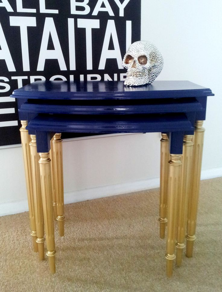 Love this stylish combo of high gloss blue with gold legs.