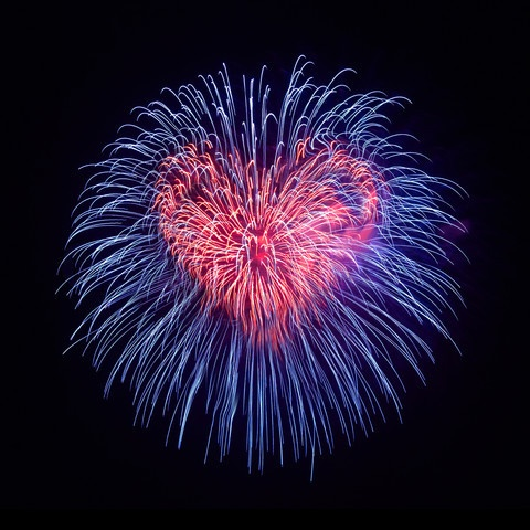 heart of fireworks on the black sky background: