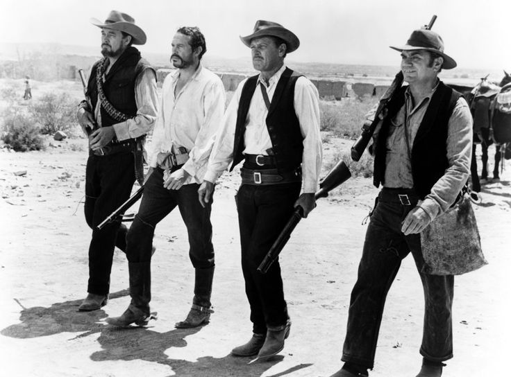 The Walk! Ben Johnson, Warren Oates, William Holden and Ernest Borgnine in The Wild Bunch (1969) from Sam Peckinpah.