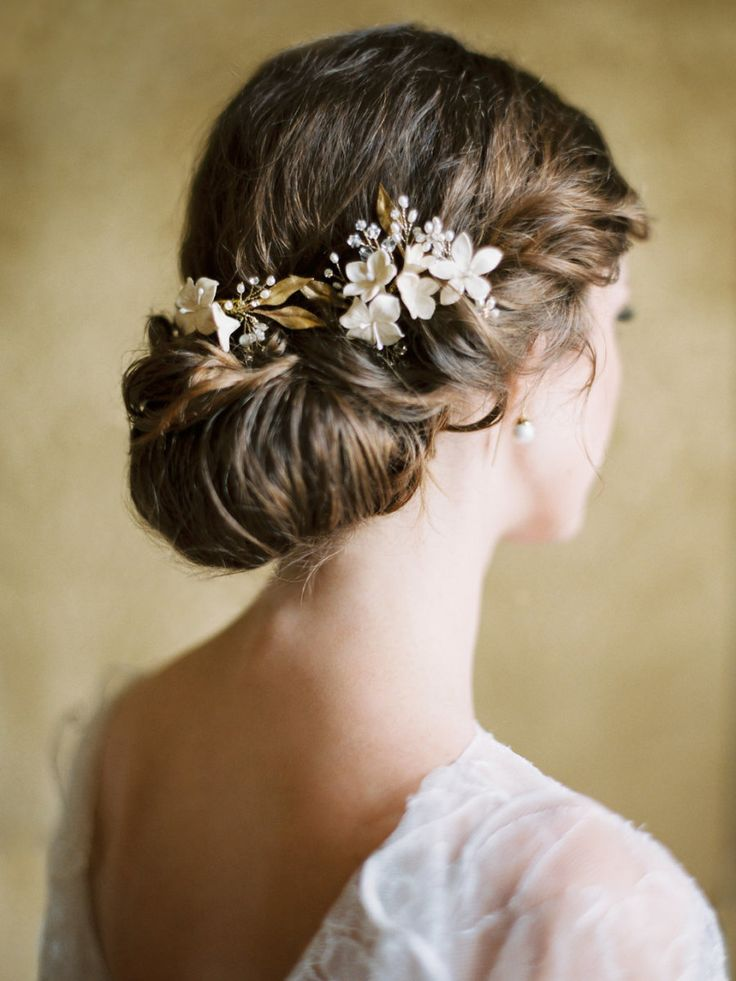 chignon bridal hair with floral accessories | Photography: Ashley Ludaescher