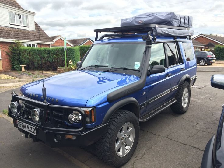 "2004 Land Rover Discovery ES Premium with: ARB Bullbar 9000lb Winch with synthetic rope HID Lightforce 170s Mantec steering guard QT diff guards 2"" HD Lift, with air on the rear 275/65/18 Cooper STTs 30mm wheel spacers EBC drilled and grooved discs Safari 'style' snorkel ALIVE tuning Stage 2 Package ARB Compressor Ashcroft rear air locker Tree sliders Cb radio Flatdog Rax ARB RTT + Awning ARB 35L Fridge + Slide Window Guards + Mantec shelf"