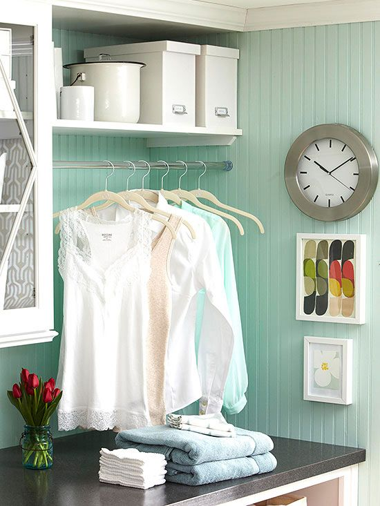 Accessorize On the Cheap - Affordable accessories coax valuable function from underused walls and crevices. A shower curtain tension rod spans an open area between the upper cabinets and a wall to become a hanging rack for items fresh out of the dryer or just off the ironing board.