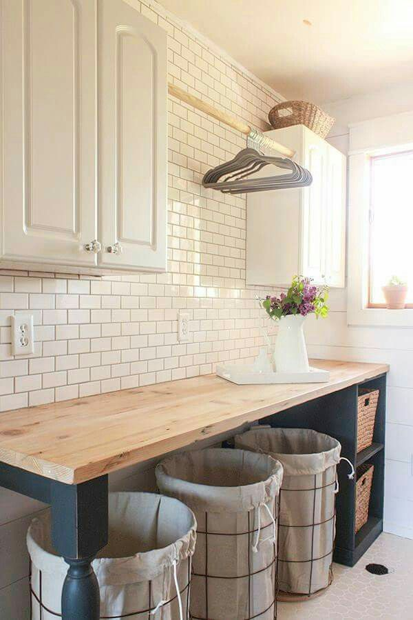 Pretty folding area in laundry room  http://www.twelveonmain.com/diy-wire-laundry-baskets/