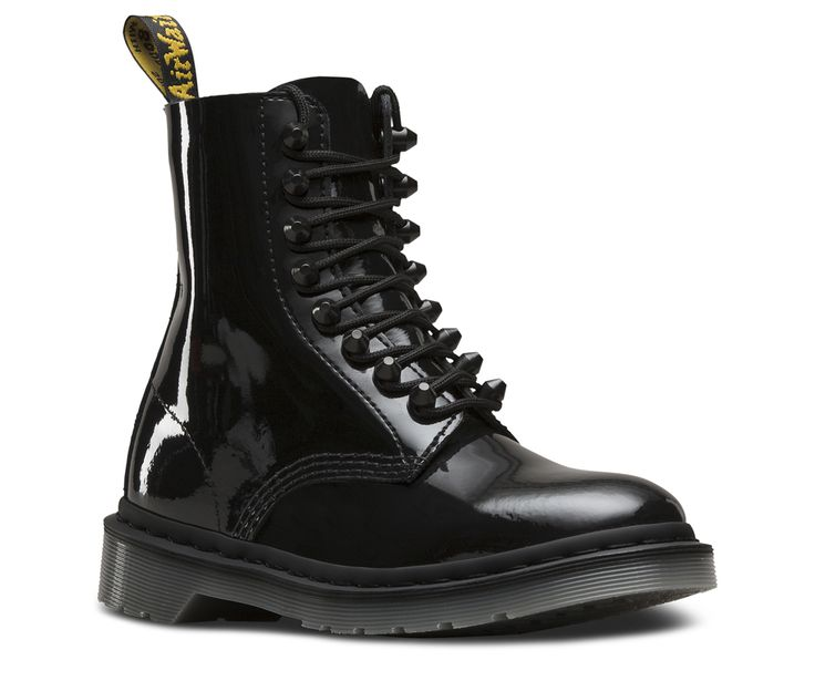 Eyelets: are they utilitarian, or fashion? How about both: this update to the classic 8-eye Pascal boot features tunnel stud lacing, glossy, high-shine patent leather and contrast grey soles — for a decidedly gothic vibe. Made with Patent Lamper, a classic high-gloss patent leather Built on the rebelliously comfortable Dr. Martens Airwair™ air-cushioned sole Sole is slip-resistant with superior abrasion, and is oil and fat resistant, too The sole is secured using one of the finest…