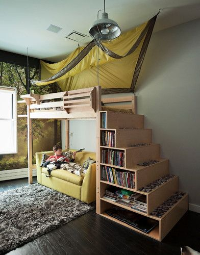 Everything a boy could want in one hideaway bedroom: a treehouse loft bed with tent canopy, a small scale sleeper sofa for reading, playing guitar and sleepover guests, and a forest view, right inside his window.