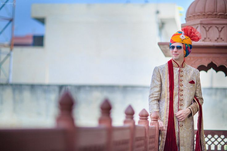 Traditional Indian sherwani and a colourful and striking turban.