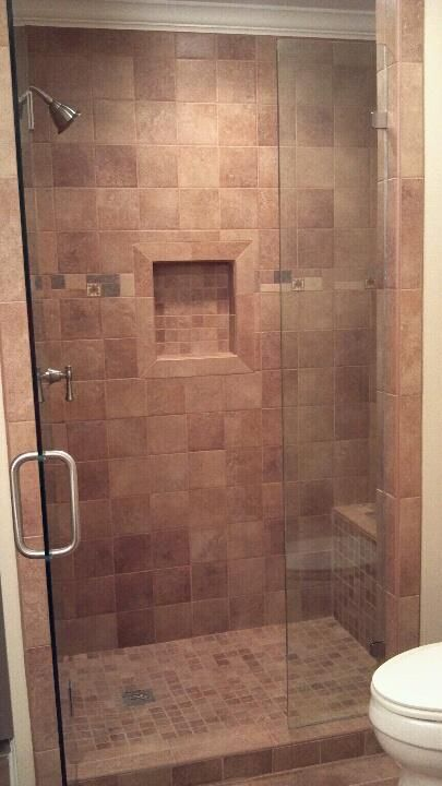 tiled shower with bench