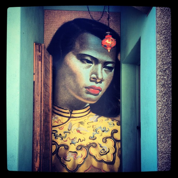 """The use of Tretchikoff's """"Chinese Girl"""" in this hallway creates a wonderful statement piece for guests to admire as they enter the house."""