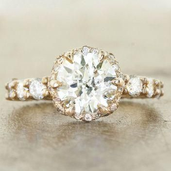 Rustic engagement rings are totally a thing (and we LOVE them). Click to see the prettiest, including this brilliant round stone set in yellow gold
