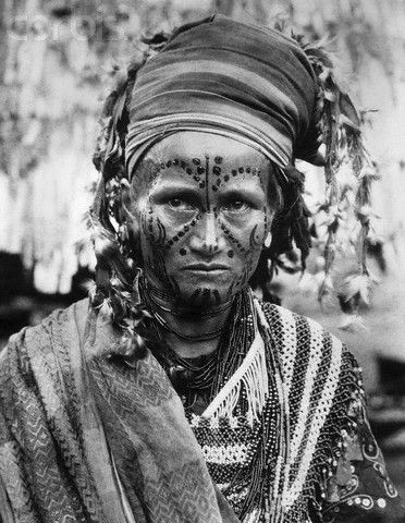 Indonesia ~ Sulawesi | Toradja Priestess in Traditional Dress. Sulawesi Selatan Province | © Underwood & Underwood